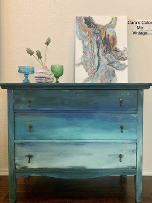 This beautiful vintage dresser would be the perfect piece to add some color to your space! It is suitable for adult spaces, but not for kids rooms. The shades of blue blend together to create a gorgeous masterpiece. Shipping is included in the price! #blue #ocean #art #furnitureart #furniturepainter #carascolormevintage #diypaint #chalkpaint #claypaint #nontoxicpaint #vintage #vintagefurniture #shopsmallbusiness #artist