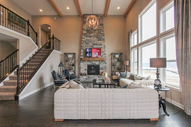We Love The Living Room In This New Home With Wood Beams A Floor To
