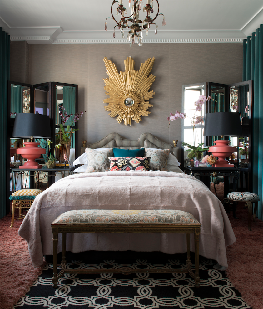 A Gold Sunburst Mirror Hangs Over This Bed For Striking Focal Point