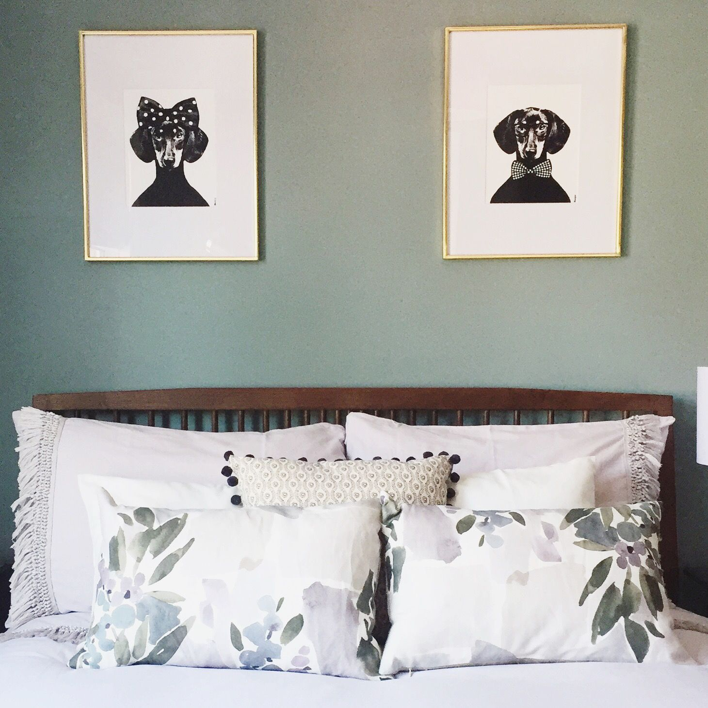 His and hers artwork above the bed in this pale teal