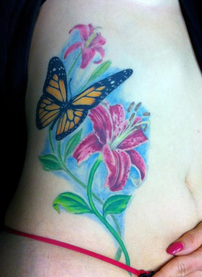 Butterfly, lily tattoo...  #tattoos #butterfly #flower