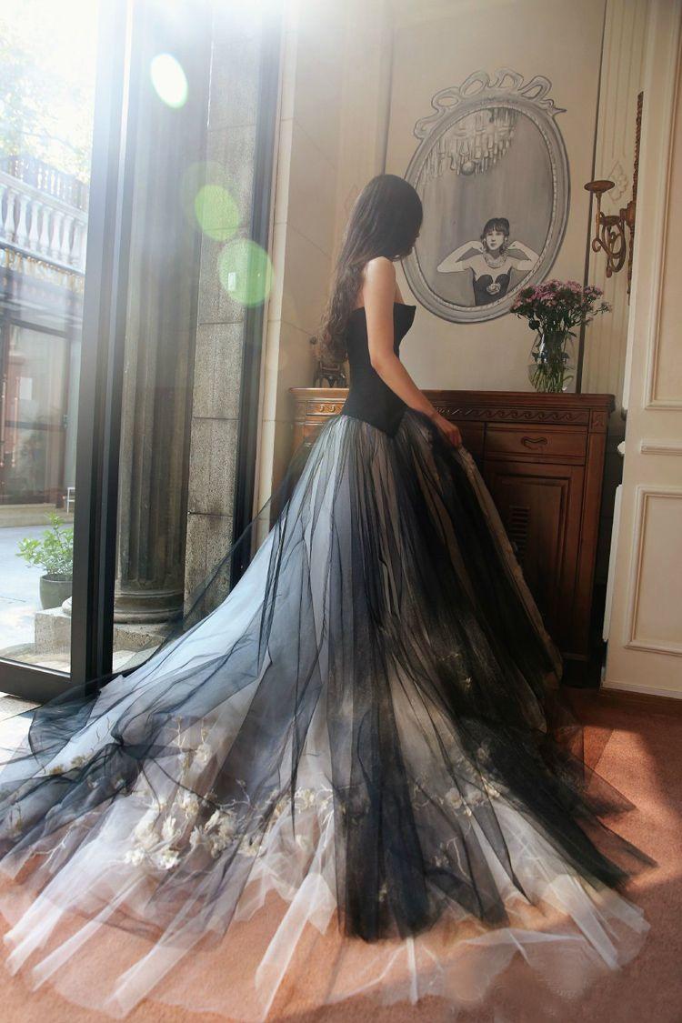 slim waisted black aura tail wedding dress
