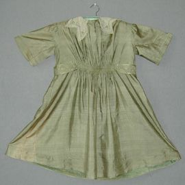 Child's sage green tussore silk Liberty dress with embroidered ivory net collar, English, c. 1910.