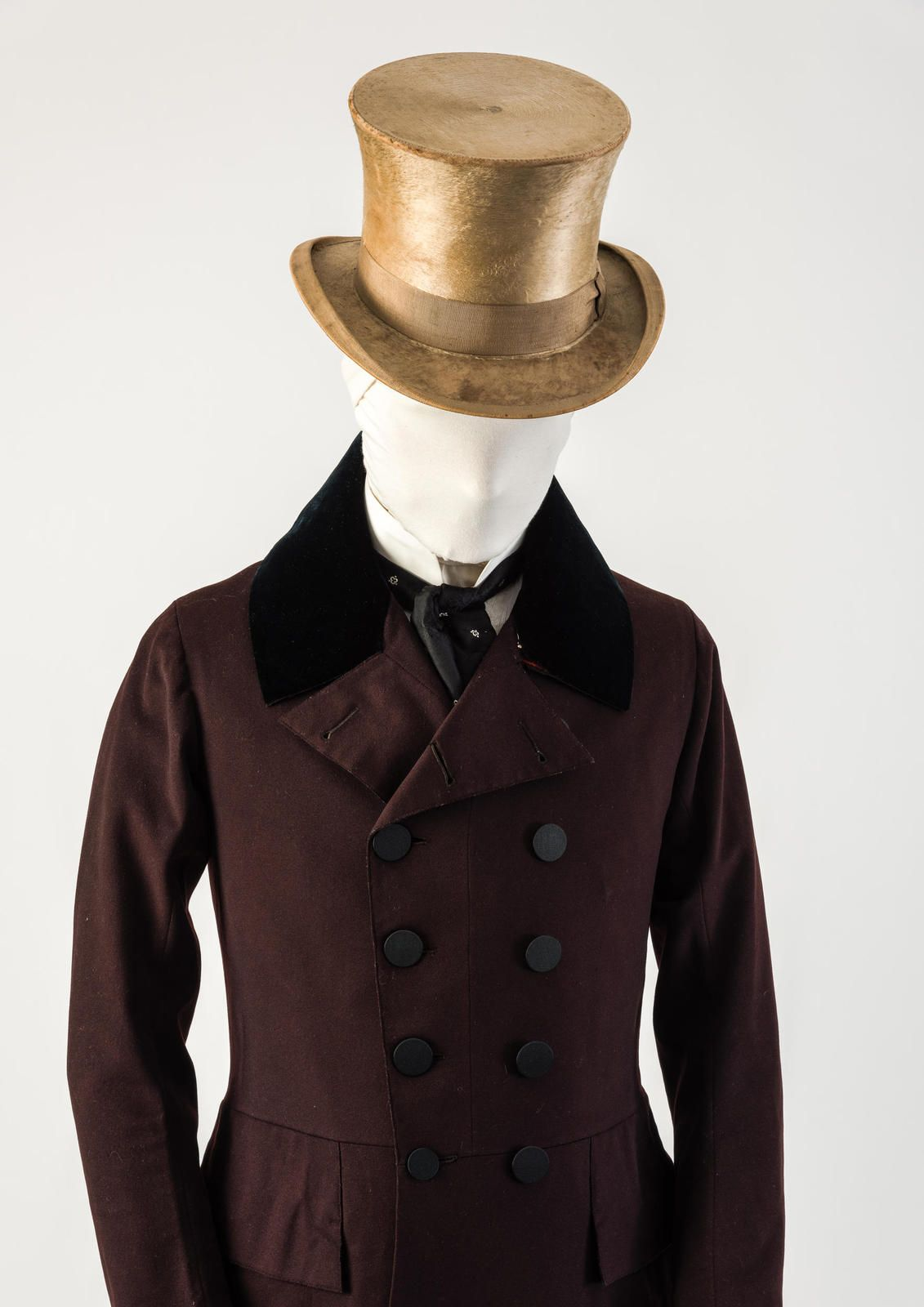 c1f5406f7f9 A frock coat and beaver top hat. Also a neck tie common from 1820-1850.  www.fashionmuseum.co.uk galleries history-fashion-100-objects-gallery