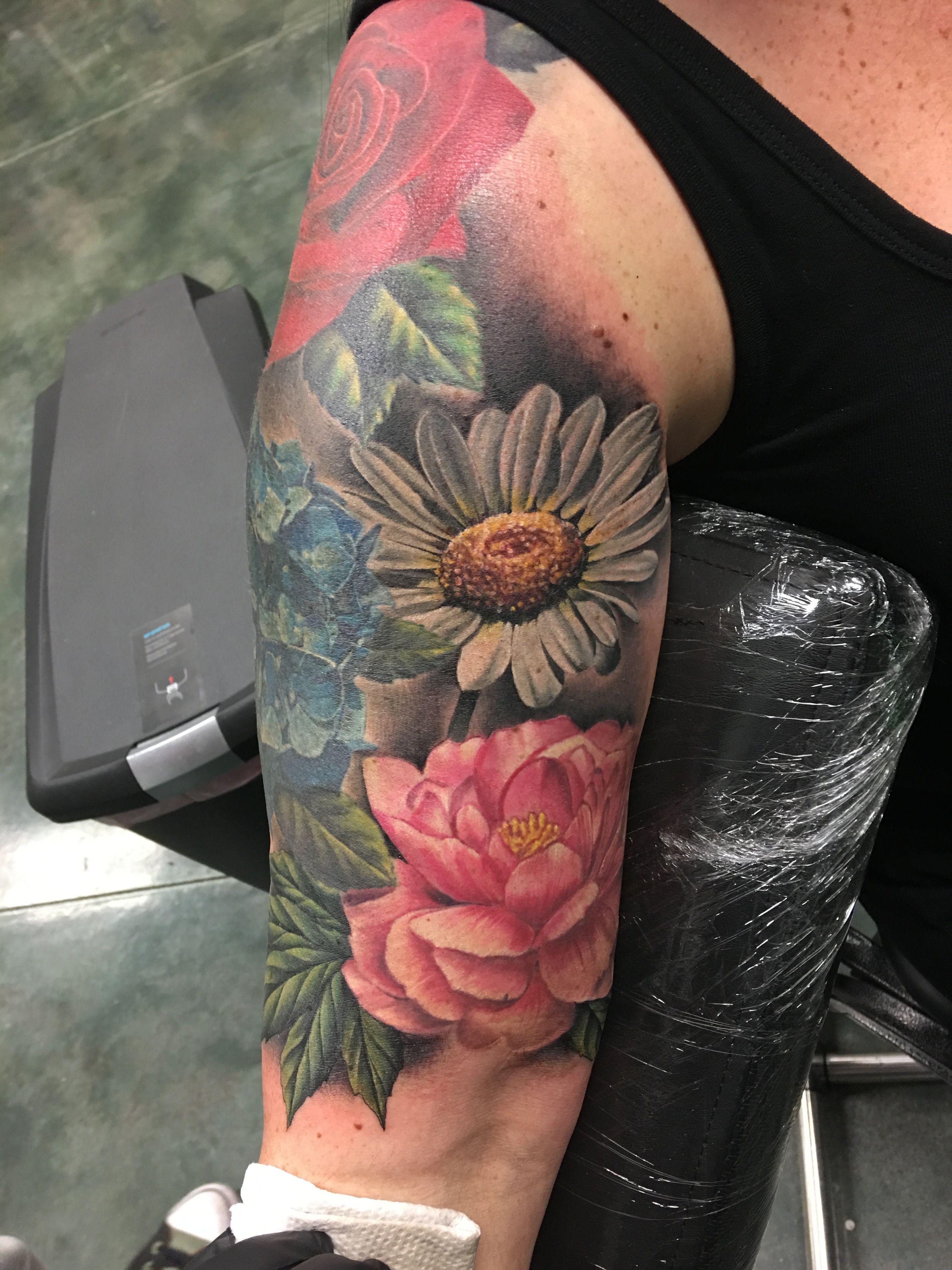 Seth Holmes tattoo, daisy, peony, hydrangea, rose, floral
