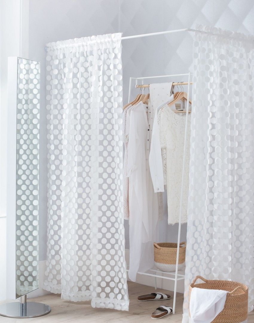 Create a freestanding 'walk-in wardrobe' with sheer fabrics and a corner rail
