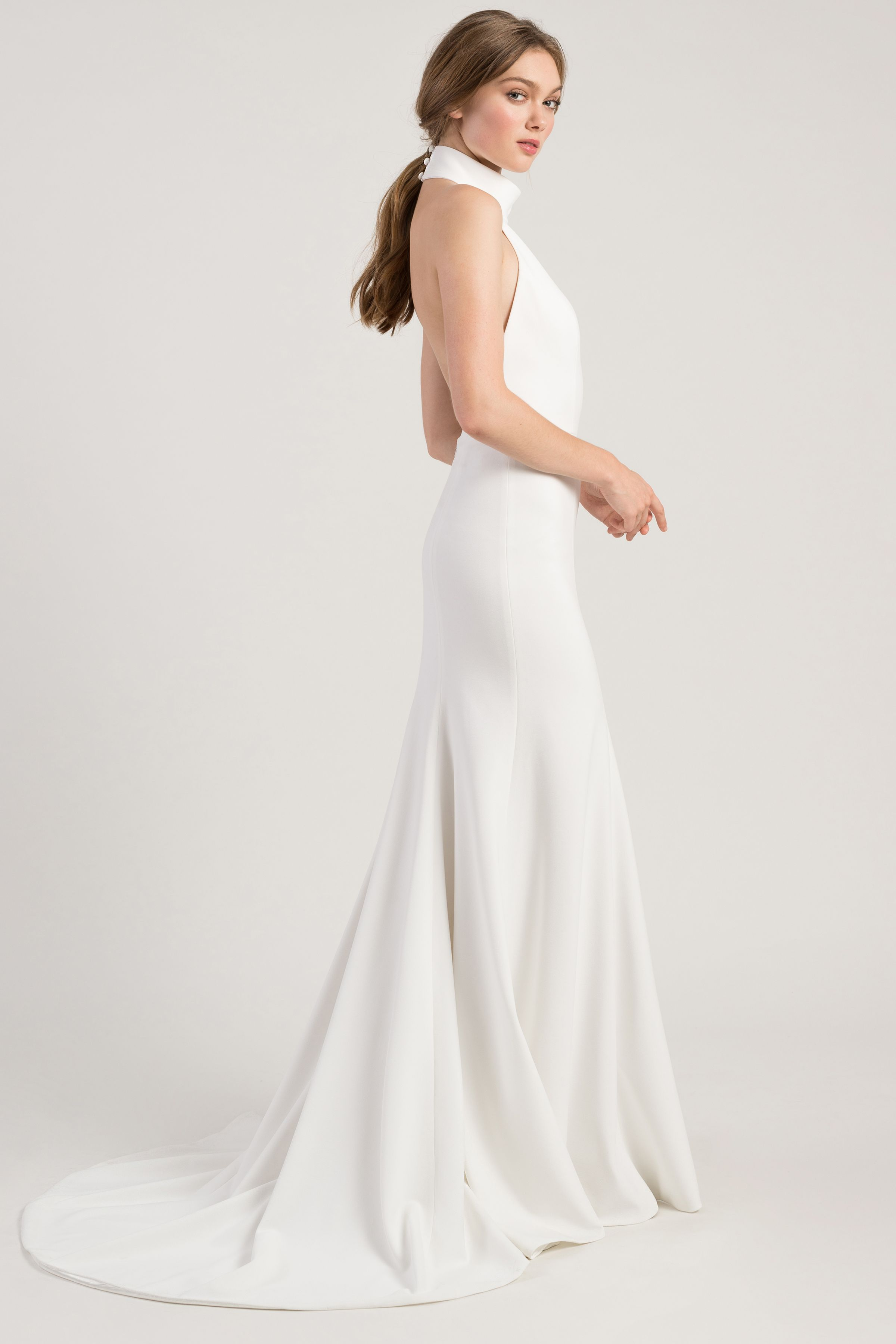 70406c2be6d The Jenny by Jenny Yoo Dawson gown is a modern   sleek fit   flare  silhoutte with a sophisticated halter neckline in our chic Knit Crepe.