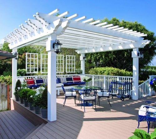 This Bright White Pergola Provides Not Only Backyard Shade But Form And Definition To The Deck Notice The Decorative Pr Backyard Shade Pergola Pergola Patio