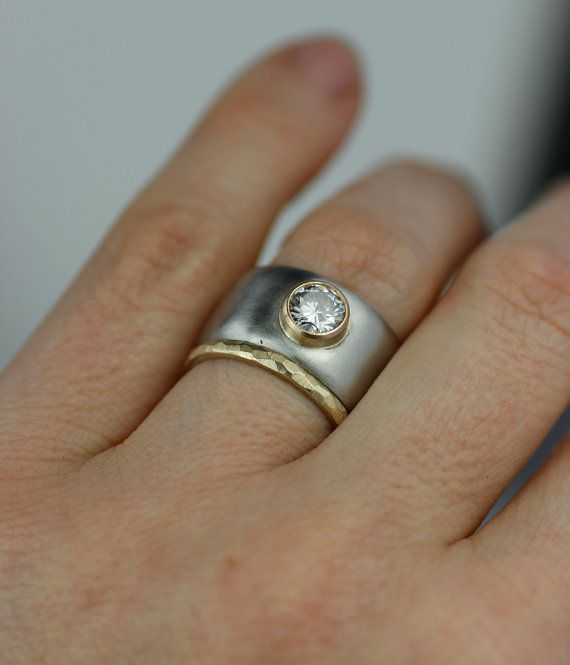full moon moissanite and palladium wide band engagment by lolide