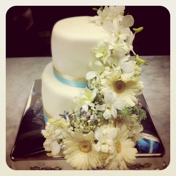 fresh flower wedding cake - fondant finish, cream and light blue ...