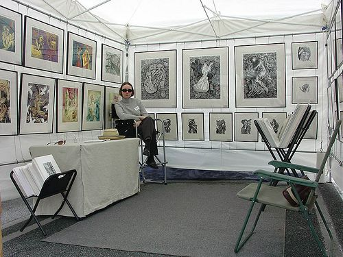 Art show by wingedlion, via Flickr ps: Remove table & self, freely turn over the space to buyers, it's all about them!