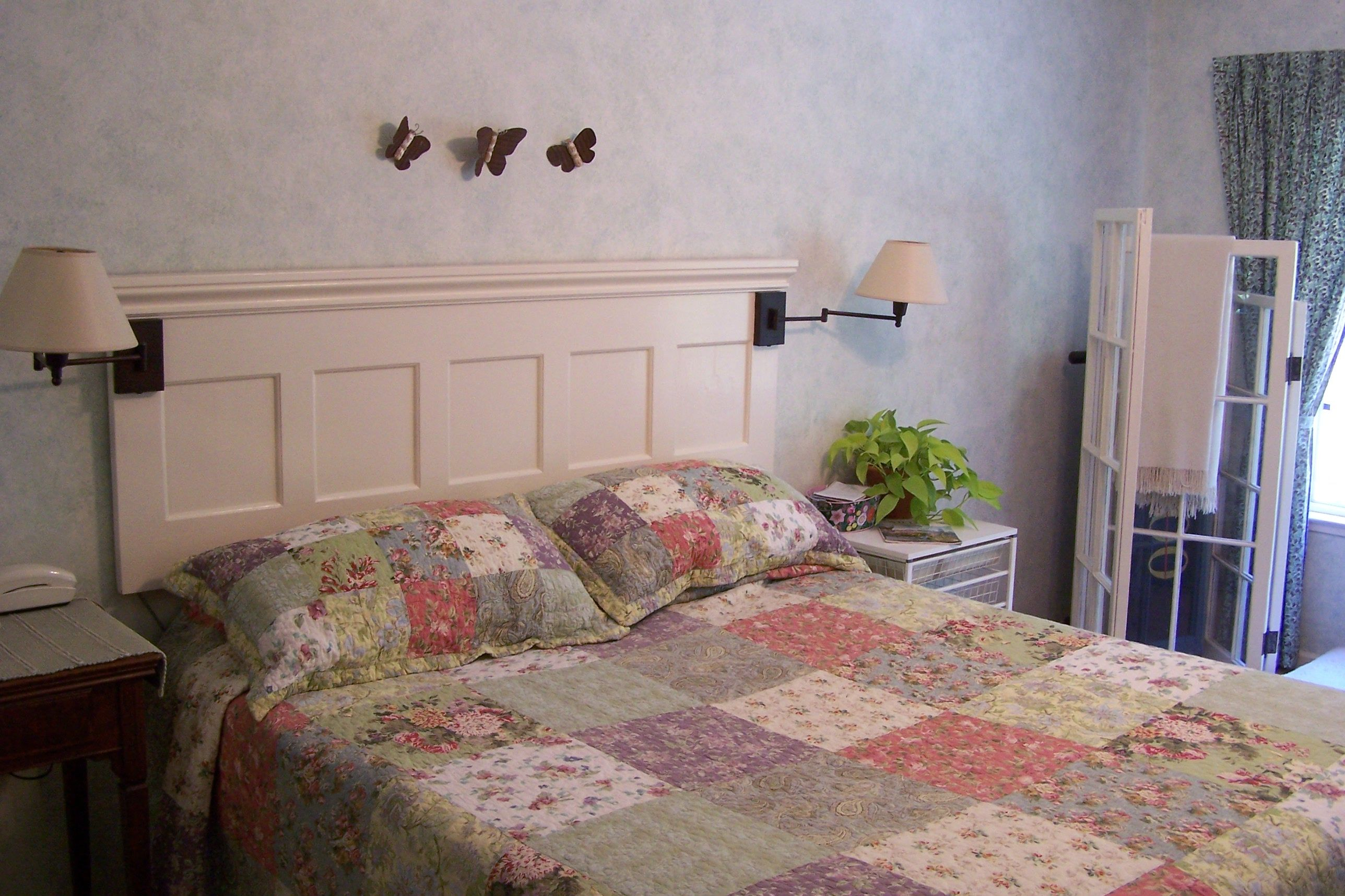 Headboard was made from redwood paneling and trim found at the salvage yard. kim*