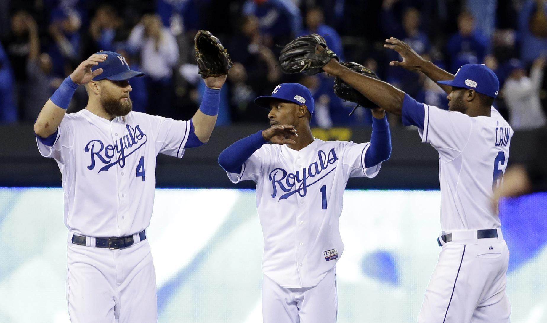 Kansas City Royals' Alex Gordon (4), Jarrod Dyson (1) and Lorenzo Cain (6) celebrate after Game 6 of baseball's World Series against the San Francisco Giants Tuesday, Oct. 28, 2014, in Kansas City, Mo. The Royals won 10-0 to tie the series at 3-3. (AP Photo/David J. Phillip)