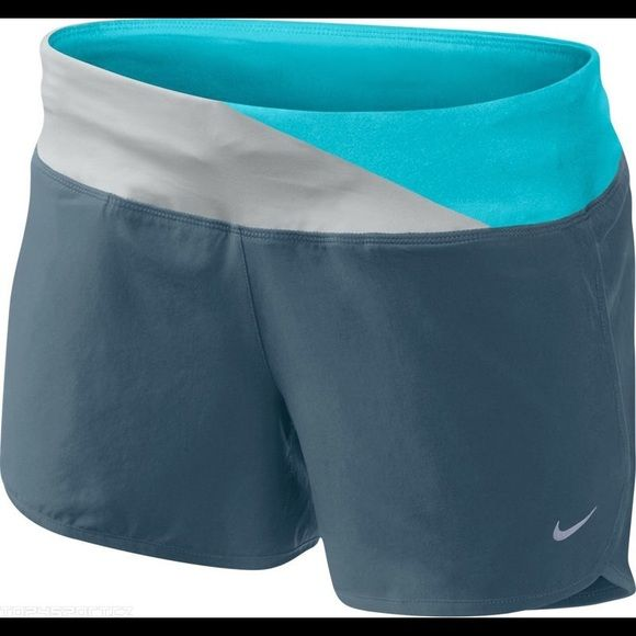 """Nike 4"""" Rival Women's Running Shorts Dark grey shorts with blue and bone colored waist band. Built in underwear/lining the same grey as the shorts. Nike Shorts"""