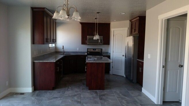 New Kitchen Cherry Wood Cabinets Stainless Appliances Grey Walls Tall White Trim Grey Tile And Azul Plantin Cherry Wood Cabinets Grey Walls Cherry Cabinets