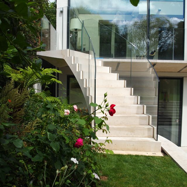 Best A Post Tensioned Stone Helical Staircase At Addison 640 x 480