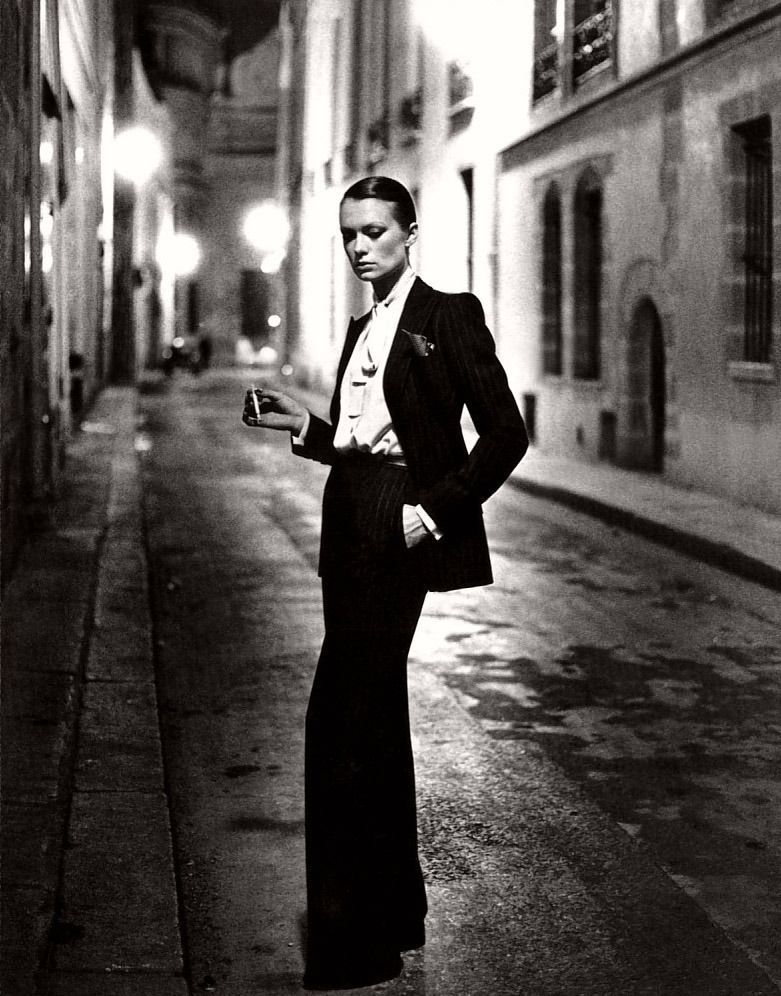 56631917c2f fashion photography legend Helmut Newton in 1975 for French Vogue,  advertising the Yves Saint-Laurent Le Smoking Tuxedo for women