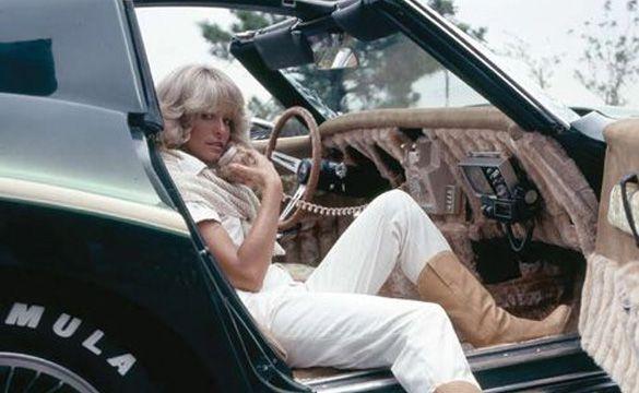 Farrah Fawcett in a customized Corvette. Love that rotary car phone!