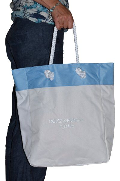 Dolce   Gabbana Light Blue Beach Bag is the perfect summer accessory. This  large sized shoulder bag comes with beautiful light blue detailing  including two ... 40fc4b72f1bea