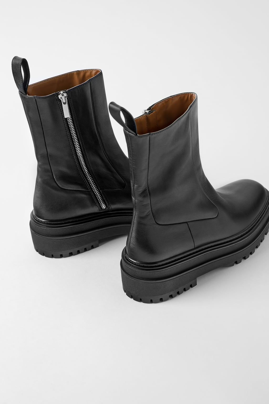 Low heeled leather ankle boots with lug