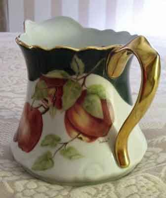 Porcelain painting of apples on a porcelain pitcher by porcelain artist and teacher, Pat McClendon
