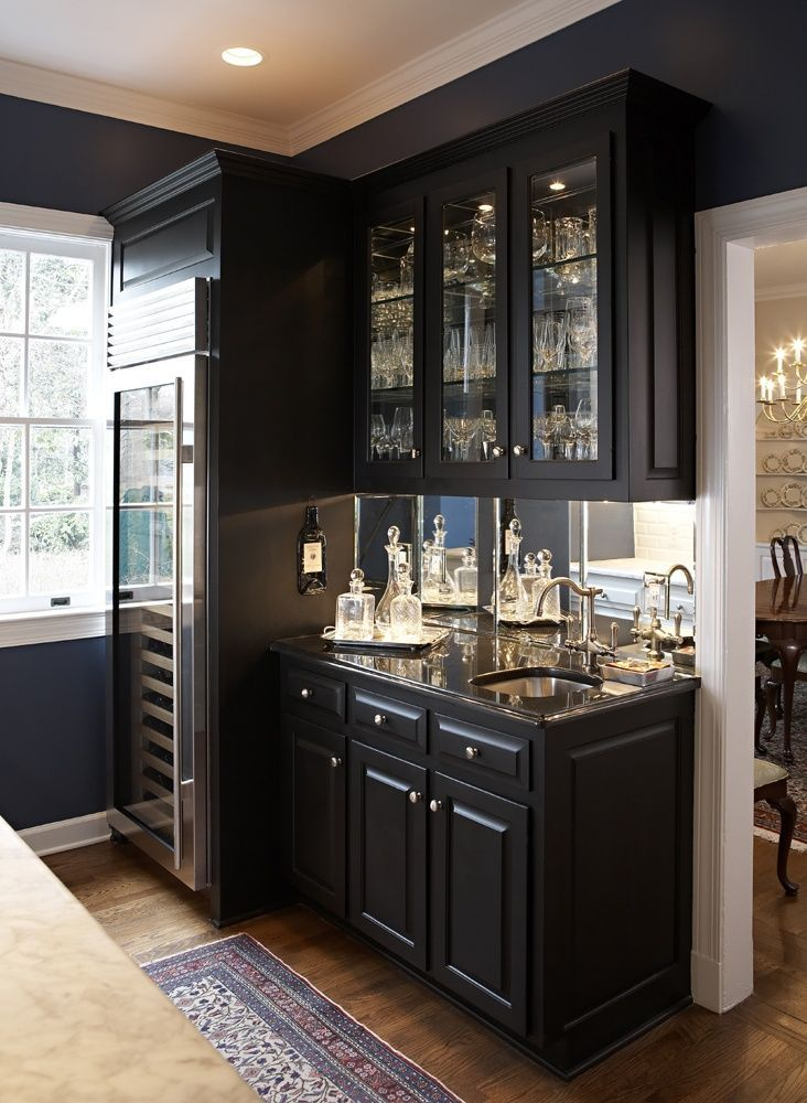 Wet Bar With Dark Cabinetry And Large Wine Fridge
