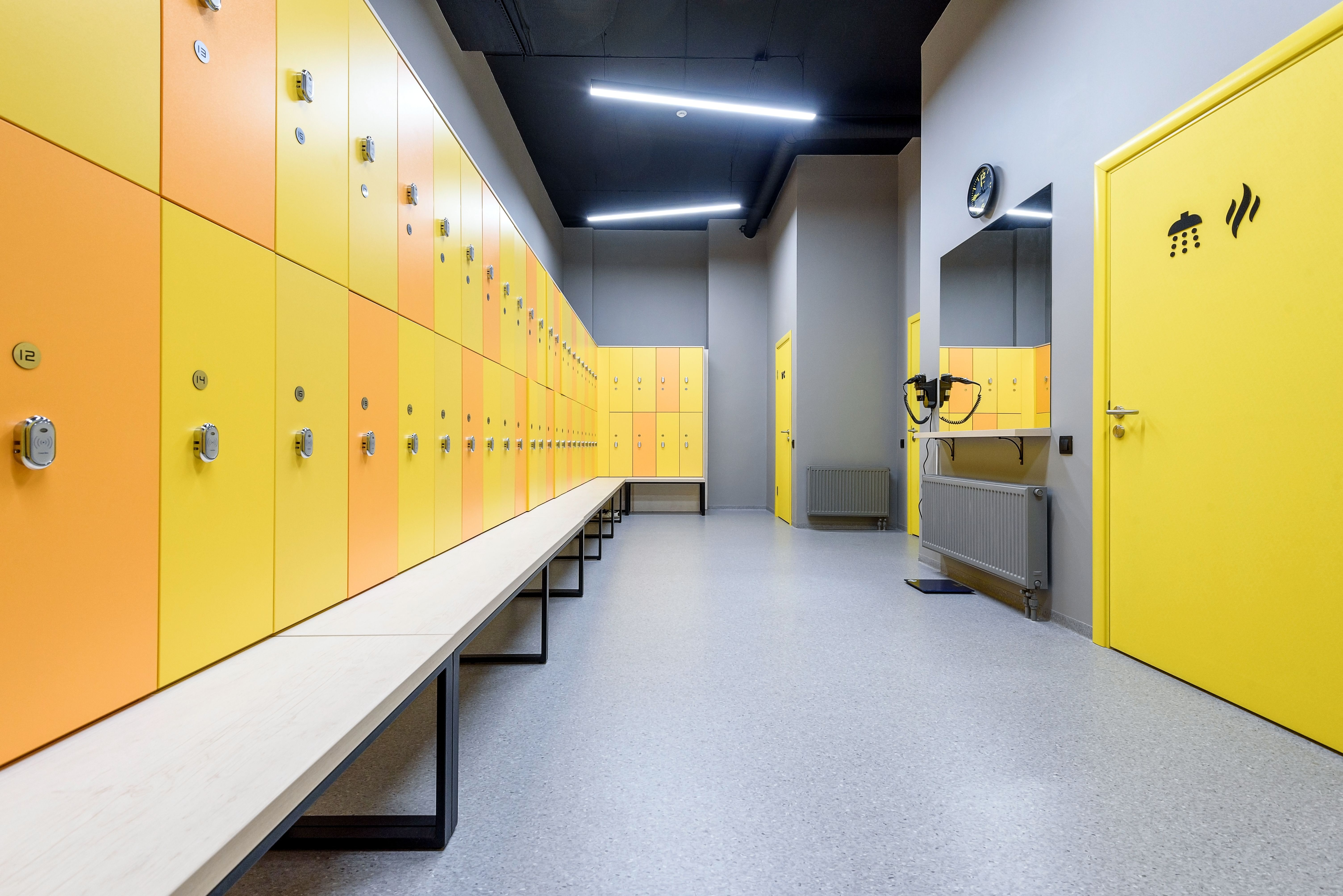 Time To Hit The Locker Room Yellow And Orange Combined With The Grey Vinyl Flooring Give It A Sleek And Mo Grey Vinyl Flooring Vinyl Flooring Locker Storage