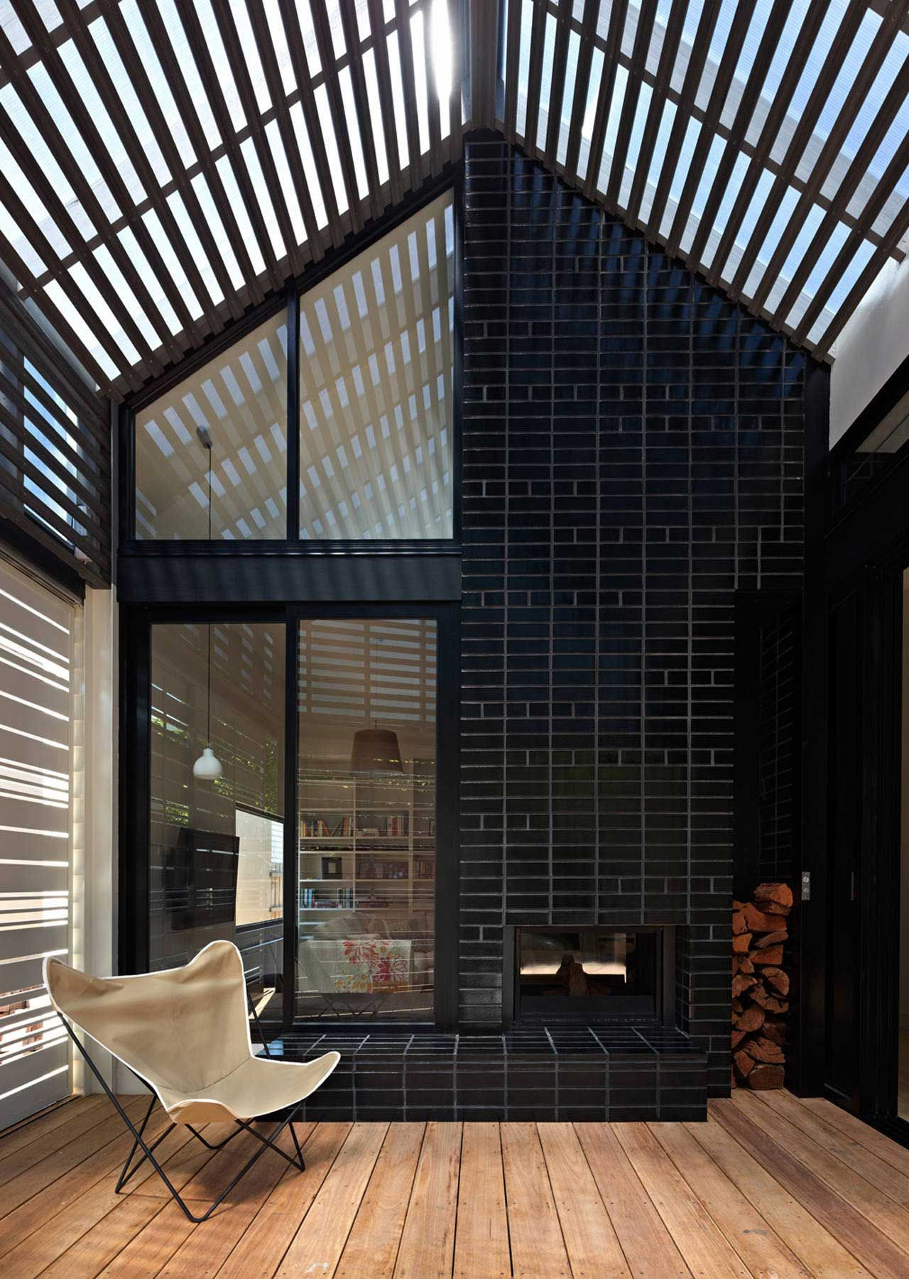 Elegant An Interesting Brick Pattern And A Double Sided Fireplace Makes A Feature  Of The Covered Deck Area In House Reduction Cheminees Philippe  Indoor/outdoor ... Great Ideas