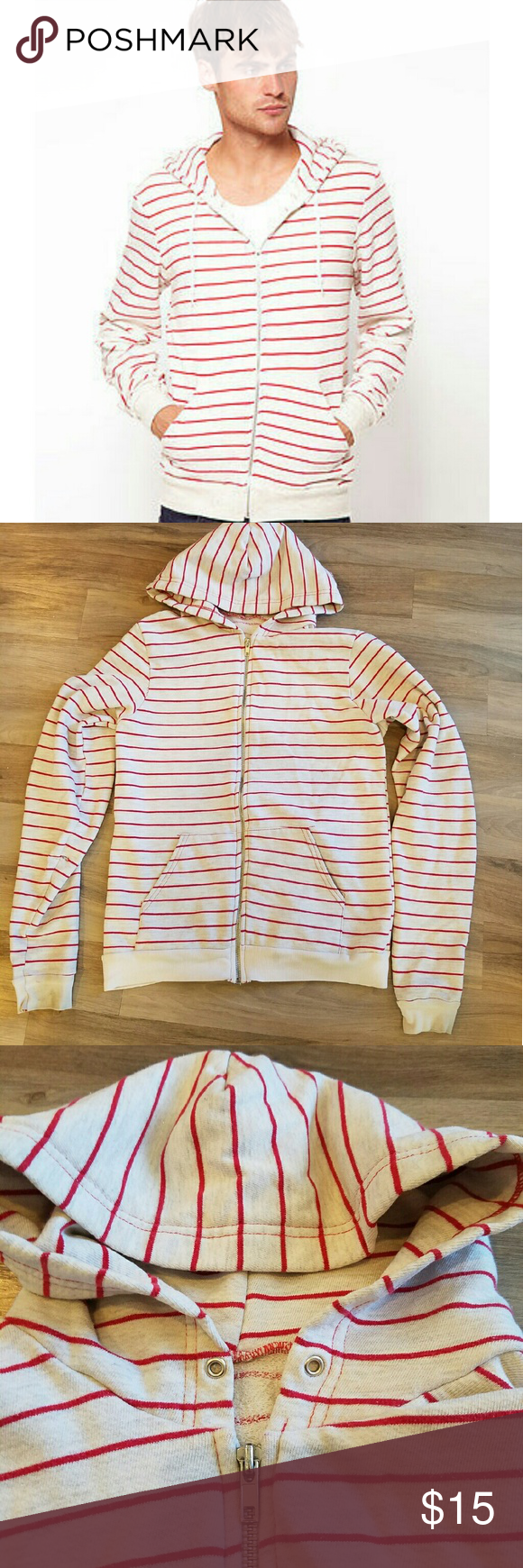 American Apparel white and red striped hoodie This unisex American Apparel hoodie is one of their most staple hoodies. It no longer has a drawstring and has a small tear in right arm sleeve. American Apparel Sweaters