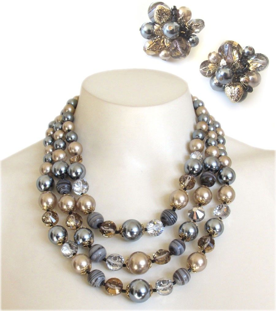Stunning vintage Vendome multistrand graduated necklace and earring set! This demi parure set features a combination of foil backed gold and silver rhinestone crystals beads, swirled smokey gray art glass beads, and a combination of soft gold and charcoal gray faux pearls! Really a sophisticated color combination, and a gorgeous high end set! The matching cluster earrings feature clip on backings with an adjustable tension design, and all three pieces are signed