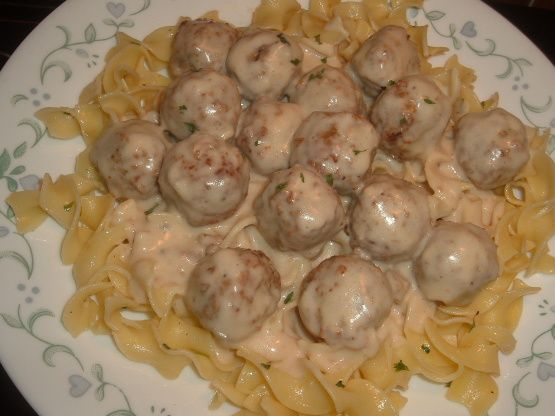 Swedish Meatballs In Sour Cream Sauce Over Buttered Egg Noodles