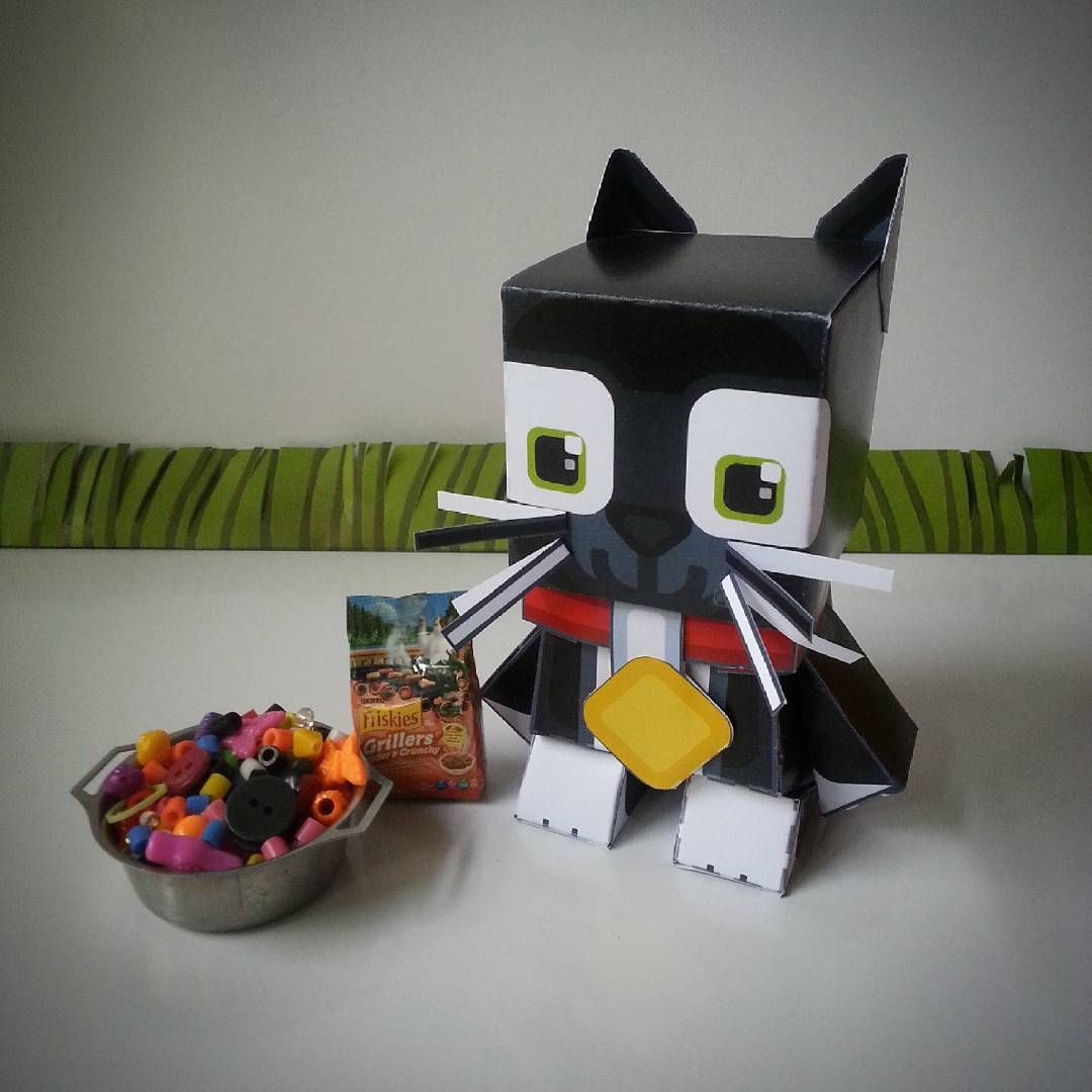 Not just any ordinary paper toy cat, oh my giddy aunt no ...