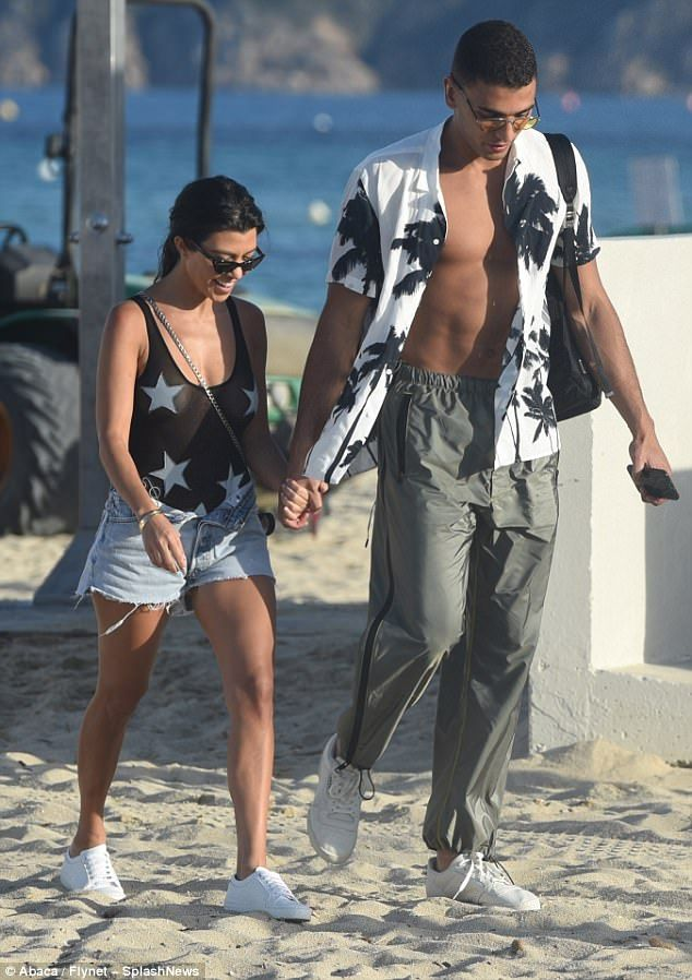 Loved-up:Kourtney is thought to have started dating the boxer, who is fourteen years her ...