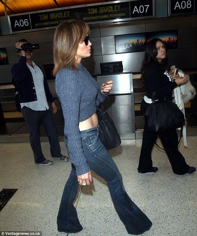 Jennifer Lopez Gets Confetti Bombed At Lax By A Clown Jlo Pinterest