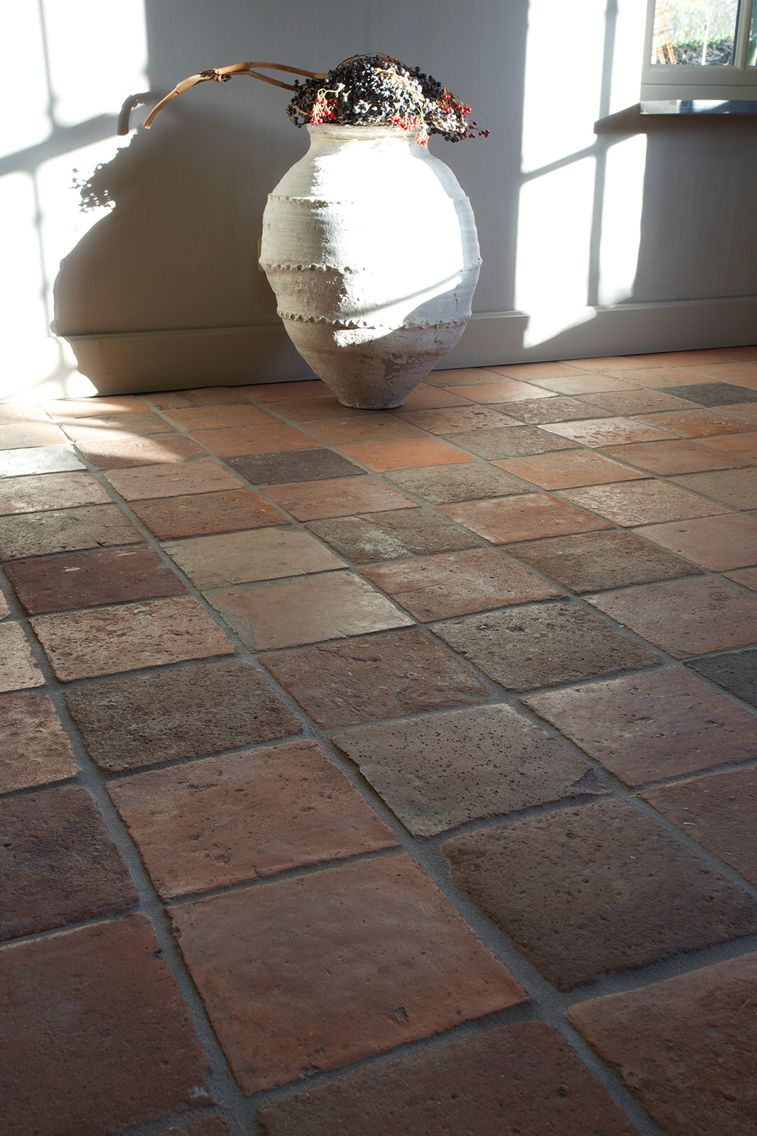 Terracotta flooring tiles pinterest terracotta breezeway antique terracotta flooring in living room with antique pot dailygadgetfo Choice Image