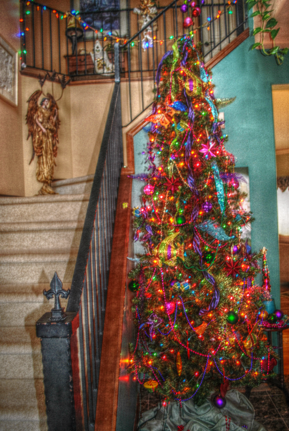christmas tree decorated in multi colored lights | Some people are ...