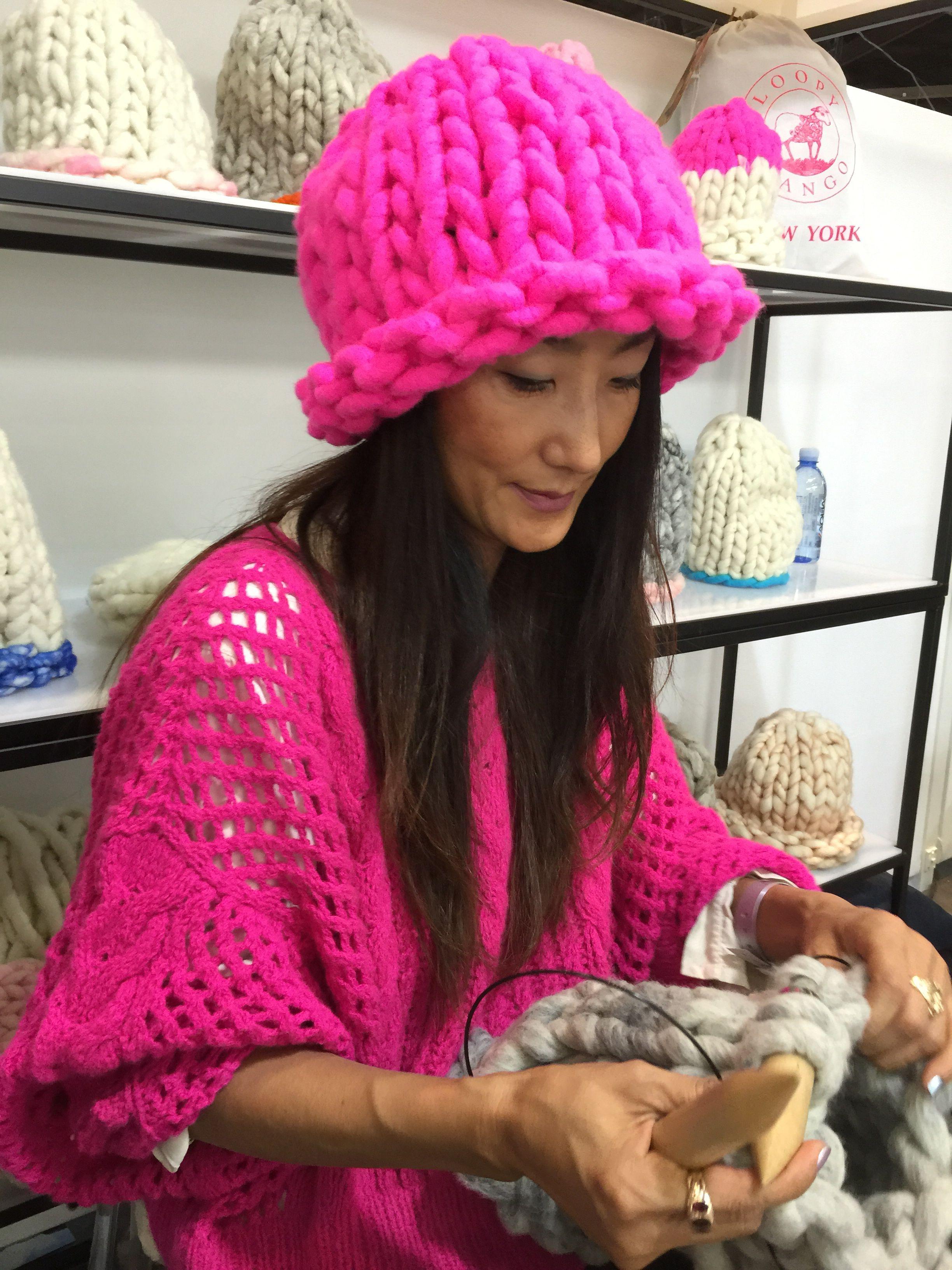 Waejong Kim - cofounder of Loopy Mango wearing Loopy Mango Helsinki Hat and Ryan Roche sweater and knitting with Big Loop Yarn