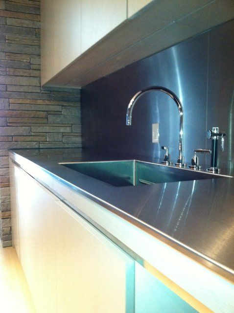 The two piece matching stainless steel backsplashes were pre-punched