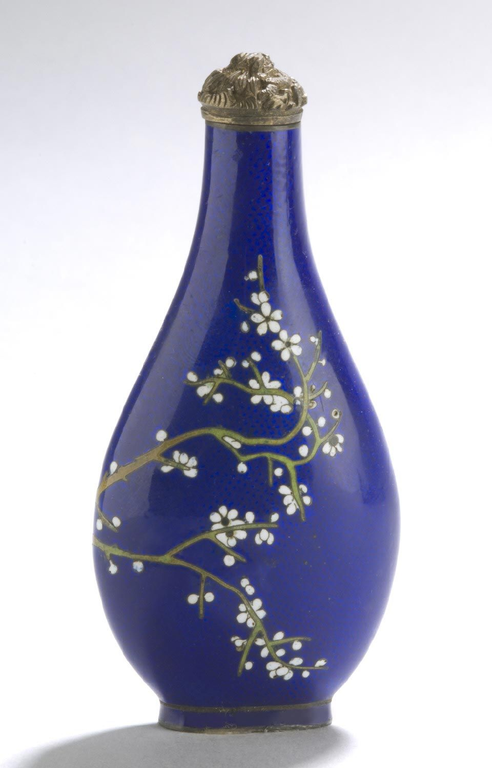 Snuff Bottle and Stopper White Cherry Blossoms Artist/maker unknown, Chinese Geography: Made in China, Asia Period: Qing Dynasty (1644-1911) Date: 1796-1850 Medium: Opaque cobalt blue glass with enamel decoration; gilded brass stopper; ivory spoon