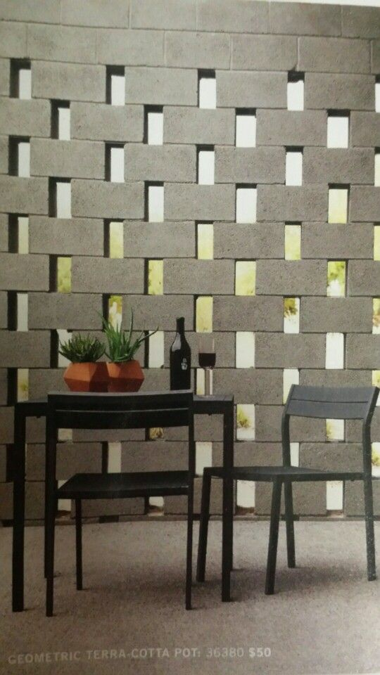 Open cinder block wall created by staggering the blocks