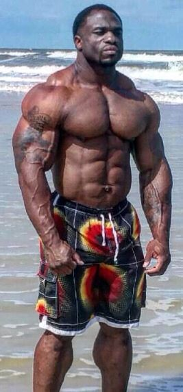 man Black on beach muscle