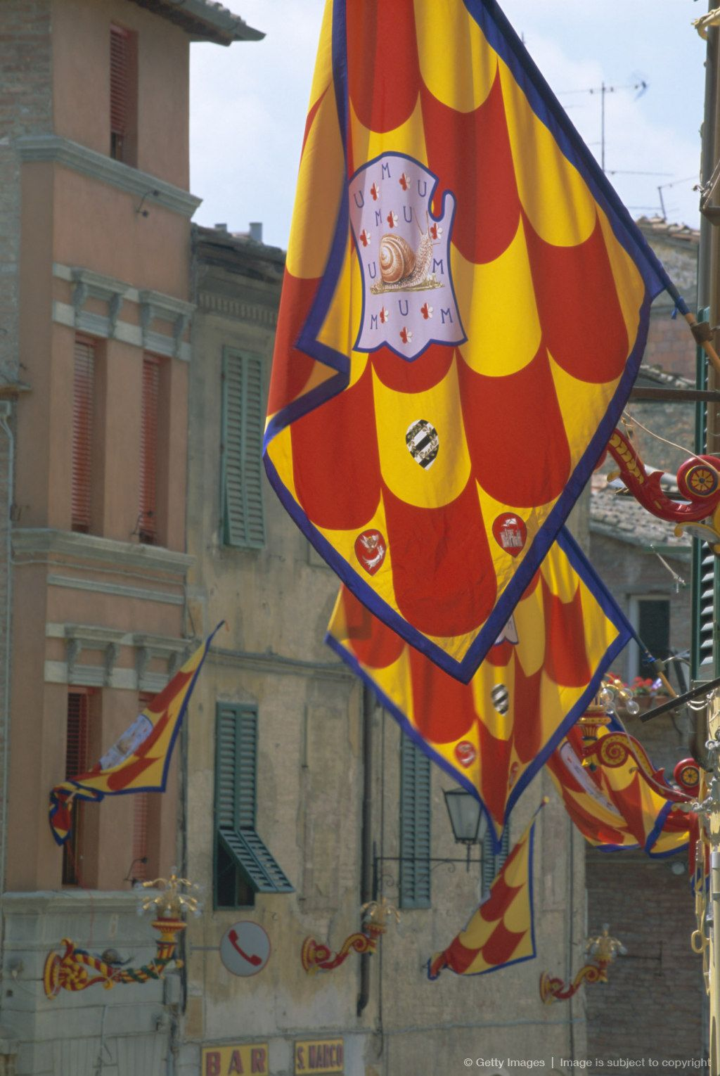 Flags and lamps of the Chiocciola snail contrada in the Via San ...