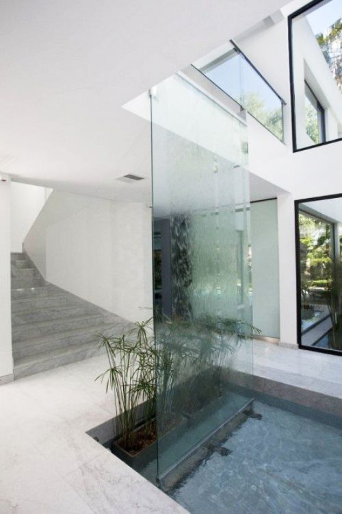 Indoor Water Feature Running Down Ceiling Height Sheet Of Glass