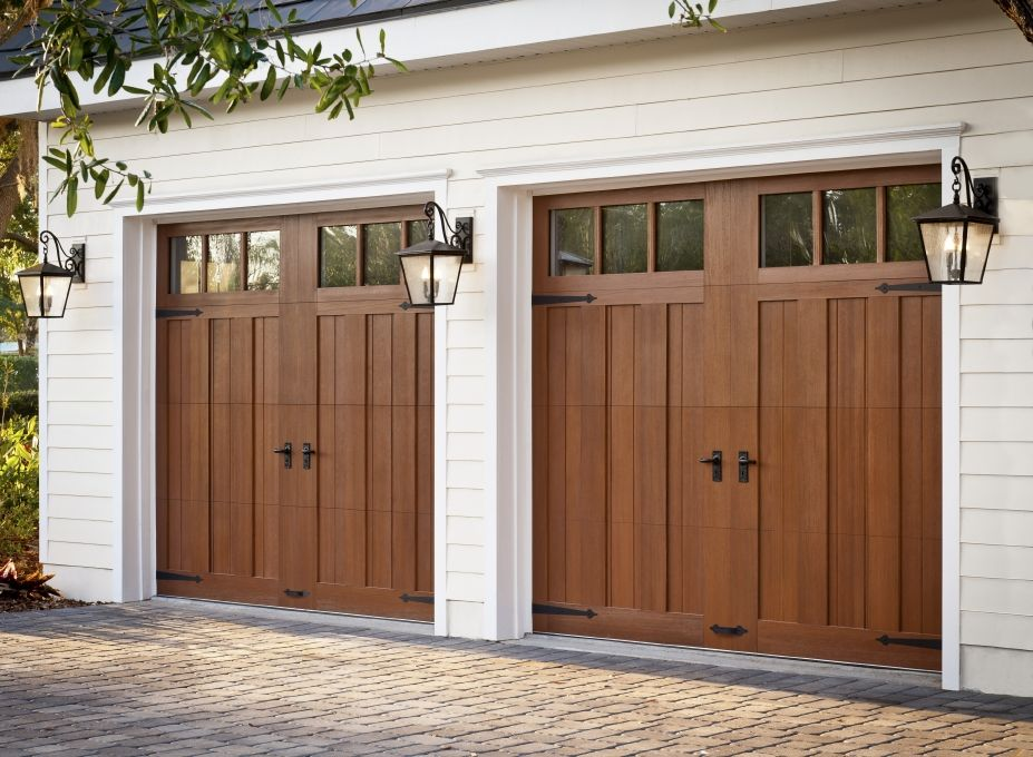 Clopay canyon ridge collection faux wood carriage house for Wood looking garage doors