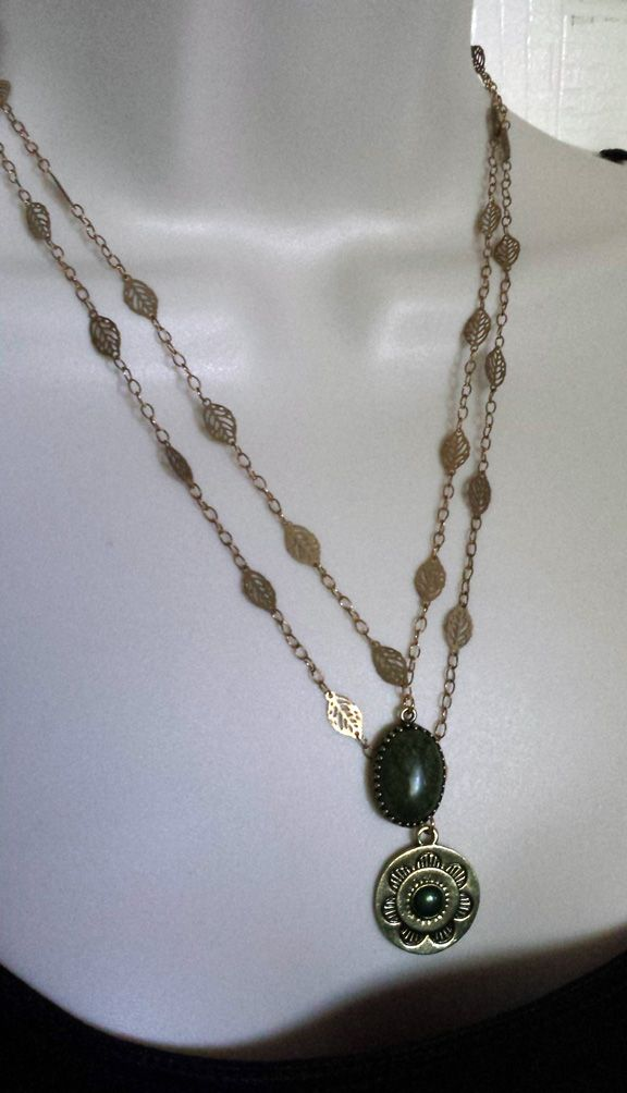 Double strand Leaf motif necklace and earring set. $24