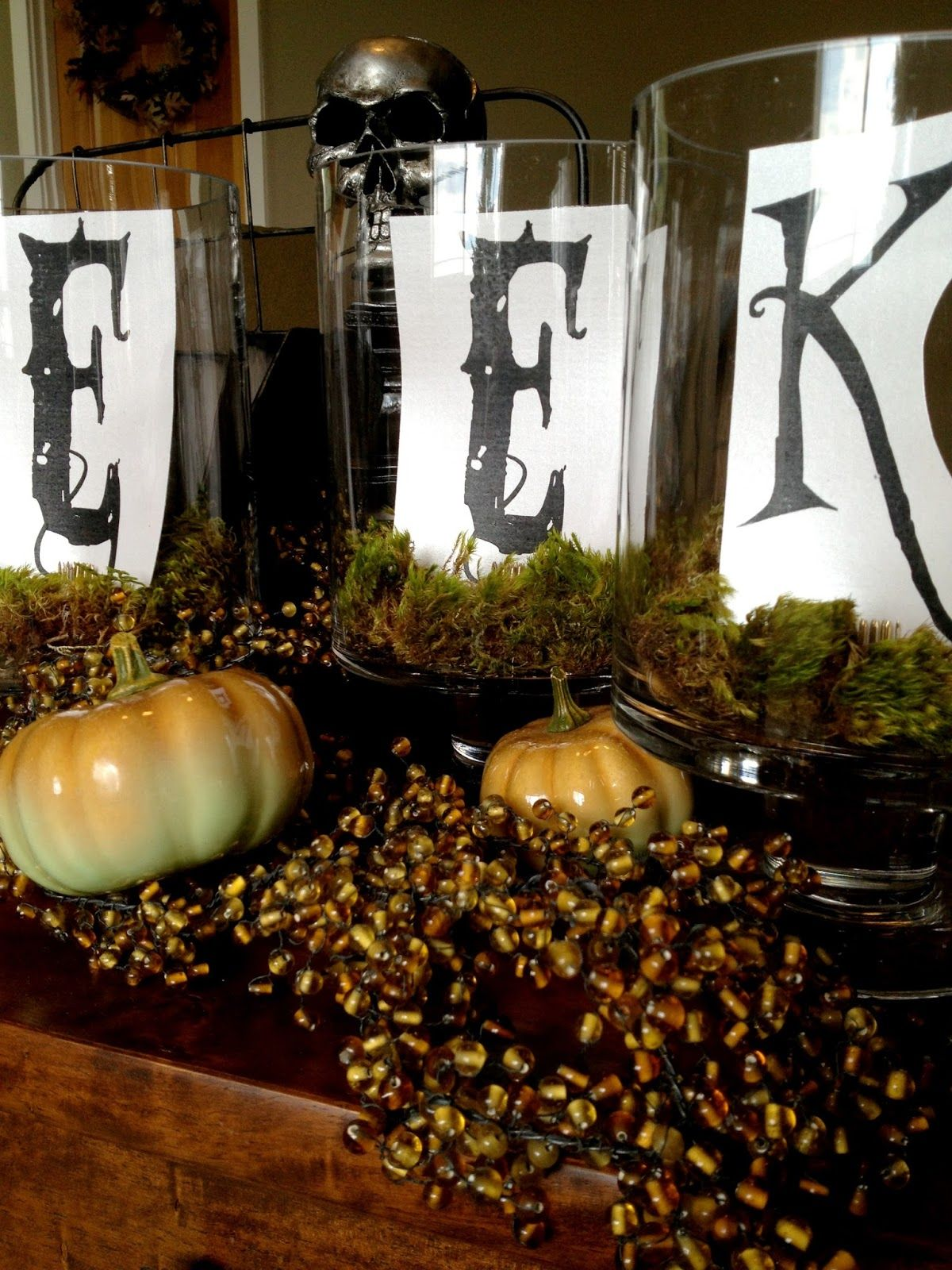 DIY simple Halloween decor - containing the eek! in glass hurricanes - Kid Friendly Halloween Decorations