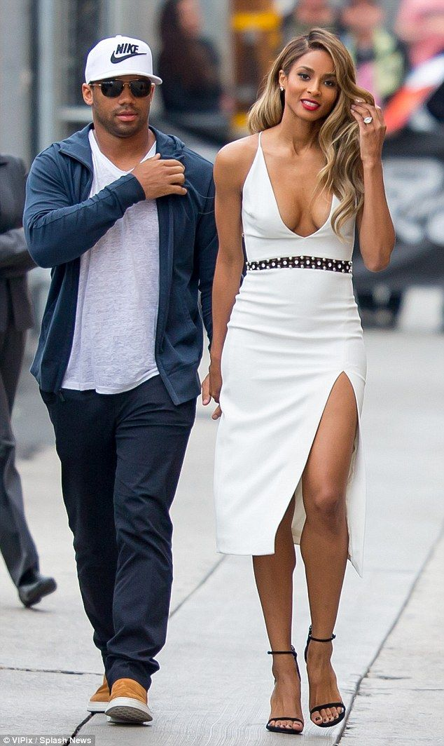 1985868e Celebrity couple: The stunning blonde was accompanied by her fiance,  Seattle Seahawks quarterback Russell Wilson, 27, who was casually dressed  in slacks and ...