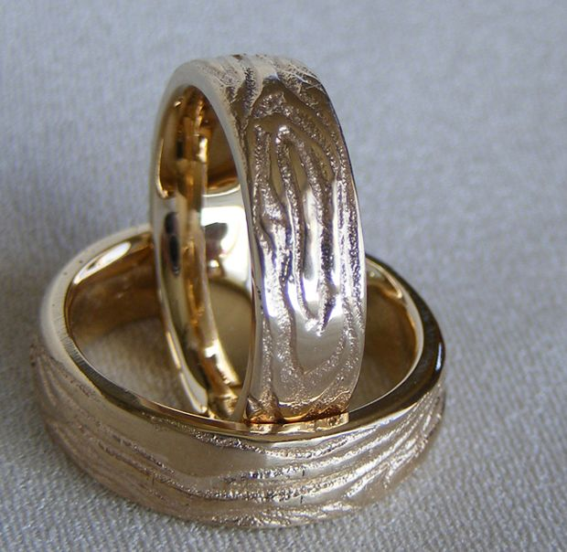 Up-cycled Jewellery Design. Woodgrain wedding bands created reusing client's old gold and the ancient technique of sand casting.