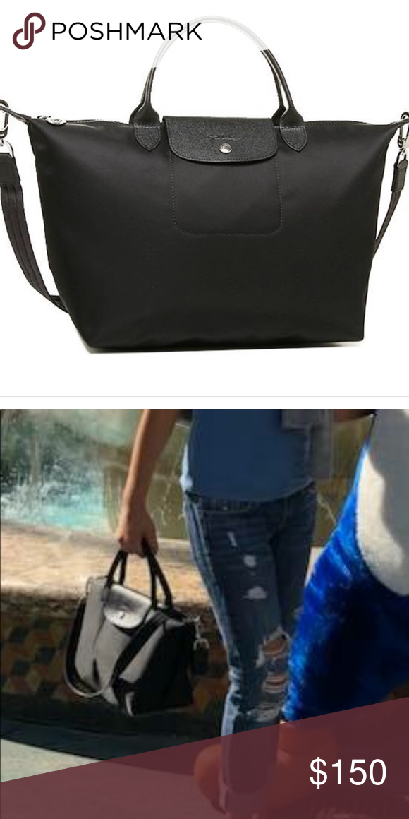 ... Removeable Crossbody strap Black nylon with black cowhide leather  details Medium size Silver hardware Great used condition Longchamp Bags  Travel Bags 16fd147e90fd5