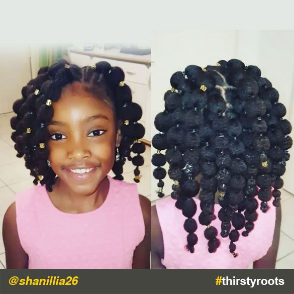 """The caption for @shanillia26 Instagram video says it all for this cute """"hair puff balls"""" hairstyle for our little black girls: """"If you can't beat the..."""